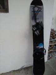 Snowboard plus Bindung,